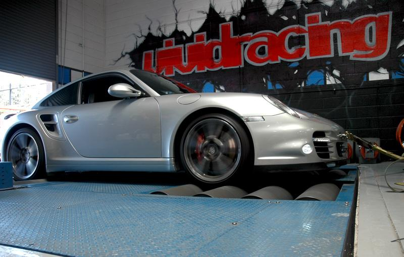 "<p>Porsche 997.2 Turbo Dyno</p><br /><div class=""wdm_img_popup"" >Share this:<br /><a title=""Facebook"" href=""http://www.facebook.com/sharer.php?m2w&s=100&p[title]=vrt-9972-tt-1&p[summary]=vrt-9972-tt-1 Porsche+997.2+Turbo+Dyno&p[url]=http://www.vrtuned.com/wp-content/gallery/on-the-dyno/vrt-9972-tt-1.jpg&p[images][0]=http%3A%2F%2Fwww.vrtuned.com%2Ftuning%2Fwp-content%2Fgallery%2Fon-the-dyno%2Fvrt-9972-tt-1.jpg"" target=""_blank""><img src=""http://www.vrtuned.com/wp-content/plugins/sharemygallery/images/facebook_share.jpg"" alt=""fshare""></a><a title=""Twitter"" href=""http://twitter.com/share?url=http://www.vrtuned.com/wp-content/gallery/on-the-dyno/vrt-9972-tt-1.jpg&text=vrt-9972-tt-1+Porsche+997.2+Turbo+Dyno+"" target=""_blank""><img src=""http://www.vrtuned.com/wp-content/plugins/sharemygallery/images/twitter_share.png"" alt=""tweet""></a><a title=""Google Plus"" href=""https://plus.google.com/share?url=http://www.vrtuned.com/wp-content/gallery/on-the-dyno/vrt-9972-tt-1.jpg"" target=""_blank""><img src=""http://www.vrtuned.com/wp-content/plugins/sharemygallery/images/google_share.png"" alt=""gplus""></a><a title=""Pinterest"" href=""http://pinterest.com/pin/create/button/?url=http://www.vrtuned.com/wp-content/gallery/on-the-dyno/vrt-9972-tt-1.jpg&media=http://www.vrtuned.com/wp-content/gallery/on-the-dyno/vrt-9972-tt-1.jpg&description=vrt-9972-tt-1Porsche+997.2+Turbo+Dyno"" target=""_blank""><img src=""http://www.vrtuned.com/wp-content/plugins/sharemygallery/images/pinterest_share.png"" alt=""pin""></a><a class=""wdm_smg_email_image"" title=""Email"" href=""#"" onclick=""wdm_smg_send_email_112();""><img src=""http://www.vrtuned.com/wp-content/plugins/sharemygallery/images/email-icon.png"" alt=""email""></a><div class=""wdm_smg_load_image_112"" style=""display:none;padding:2px;""> 		Sending <img src=""http://www.vrtuned.com/wp-content/plugins/sharemygallery/images/ajax-loader-small.gif"" alt=""Sending...""> 		</div> 		<div class=""wdm_smg_sent_image_112"" style=""display:none;padding:2px;""> Thank you for sharing the gallery image </div> 		<script type=""text/javascript""> 		function wdm_smg_send_email_112() 				{ 					var site_name = ""VR Tuned""; 					var img_url = ""http://www.vrtuned.com/wp-content/gallery/on-the-dyno/vrt-9972-tt-1.jpg""; 					var img_path = ""/var/www/vhosts/vrtuned.com/htdocs/tuning/wp-content/gallery/on-the-dyno/vrt-9972-tt-1.jpg""; 					var img_name = ""vrt-9972-tt-1.jpg""; 					var email_from = ""tuning@vividracing.com""; 					var email_sub = ""Check out this from VRTuned.com""; 					var email_before = ""View image by clicking the link:""; 					var email_after = ""This link has been shared from <a href=\\\\\\\\\\\\\\\\\\\\\\\\\\\\\\\""http://www.vrtuned.com\\\\\\\\\\\\\\\\\\\\\\\\\\\\\\\"">VR Tuned</a>""; 					var email_ack = ""Thank you for sharing the gallery image"";  					var email=prompt(""Send to email address:"","""");  					if (email!=null && email!="""") 					{ 						jQuery.ajax( 							{ 								url:""http://www.vrtuned.com/wp-content/plugins/sharemygallery/smg_email_image.php"", 								cache: false, 								data:{ 									""image_name"":img_name, 									""image_path"":img_path, 									""smg_site"":site_name, 									""smg_image"":img_url, 									""smg_email"":email, 									""smg_email_from"":email_from, 									""smg_email_sub"":email_sub, 									""smg_email_before"":email_before, 									""smg_email_after"":email_after, 									""smg_email_ack"":email_ack 								}, 								type:""POST"", 								beforeSend: function(){ 								jQuery.blockUI({ css: {  								padding: ""10px"",  								backgroundColor: ""#999"",  								""-webkit-border-radius"": ""5px"",  								""border-radius"": ""5px"",   								color: ""#fff"", 								width:""15%"", 								left:""42%"" 								}, 								message: ""<div class=\""gal_img_sending_stat\"" style=\""font-weight:bold;\"">Sending...<br /><br /><img src=\""http://www.vrtuned.com/wp-content/plugins/sharemygallery/images/ajax-loader.gif\"" alt=\""Sending...\"" /></div>""}); 								jQuery("".wdm_smg_load_image_112"").show(); 								 }, 								 complete: function(){ 								 jQuery.unblockUI(); 								 jQuery("".wdm_smg_load_image_112"").hide(); 								}, 								success: function(data){ 								apprise(data); 								 } 							} 							); 					} 				} 		</script></div>"